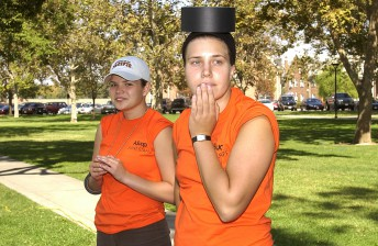 Alumni volunteers take a breather from setting up for the University of the Pacific's annual homecoming event in Stockton, Calif. October 3, 2003.
