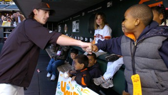 Tim Lincecum fist bumps a young fan who came with a group of children from the San Francisco School Alliance to present a gift to the Giants ace for winning the National League Cy Young Award at ATT Park in San Francisco, April 8, 2009.