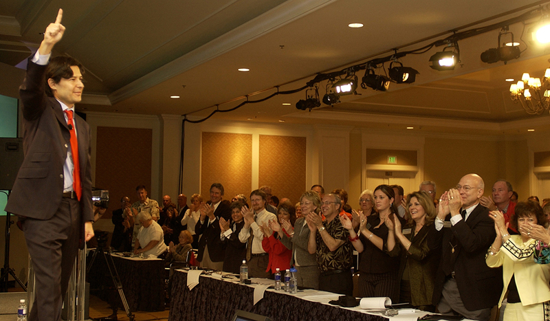 Shaklee employees cheer their new CEO Roger Barnett during an event at the Ritz Carlton in Half Moon Bay, Calif., April 23, 2004.