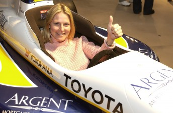 An Argent employee enjoys a moment in a signature vehicle during an event at the Bill Graham Civic Auditorium in San Francisco December 6, 2003.