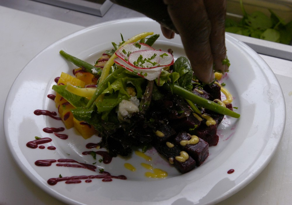 Magnolia's new chef Eddie Blyden takes a moment to show off one of his new menu items in the kitchen July 12, 2006.