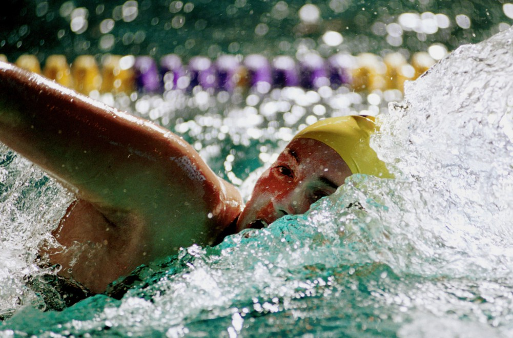 SF State swimmer Emily Keller shows her stuff during the 2nd heat of freestyle at the Gators vs. Mills meet in the Swamp January 24, 2003.  The Gators excelled in every heat, guaranteeing them a spot in the championships.