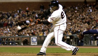 Barry Bonds connects for career homerun number 661, surpassing godfather Willie Mays on the all-time list at SBC Park in San Francisco April 13, 2004.