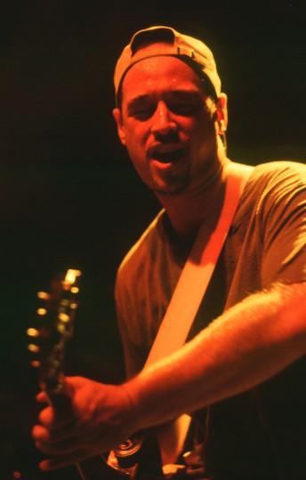 Train guitarist Jimmy Stafford performs at the Fillmore Auditorium in San Francisco, May 11, 1996.