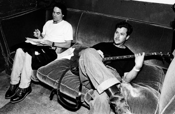 Train lead singer Pat Monahan designs the set list while bassist Charlie Coliin hangs out backstage before a show at Slim's in San Francisco, May 17, 1997.