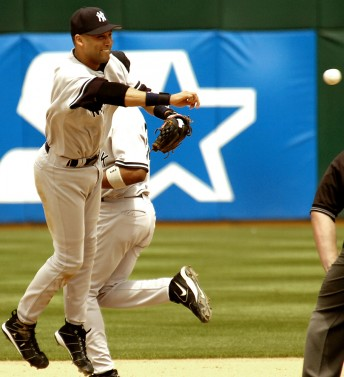 Yankees shortstop Derek Jeter turns a double play against the A's at the Oakland Coliseum, May 15, 2005.