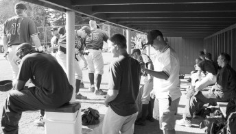 In the dugout at Sonoma State University.
