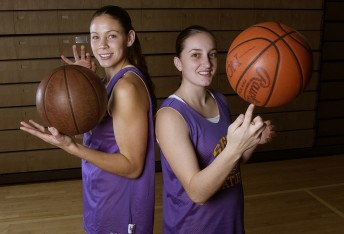 Gator basketball players Chrissy Ridenour (left) and Mindi Martinez show their stuff before a game at the Swamp December 3, 2002.