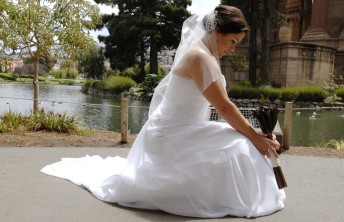 Kathryn takes a moment on her wedding day at San Francisco's Palace of Fine Arts, July 18, 2014.