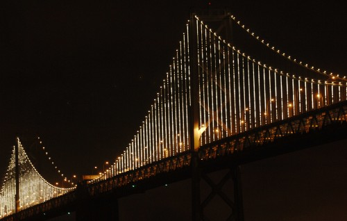 The Bay Bridge with its ever rotating and trippy lights as seen from the Embarcadero in San Francisco, July 8, 2014.