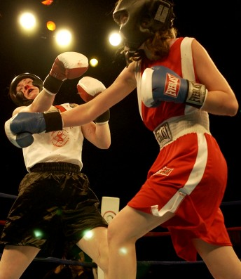 Elizabeth Cole (in red) delivers what would turn out to be the knock out punch to Aryan Carrillo during the 2005 Golden Gloves competition at the Bill Graham Civic Auditorium April 2, 2005.