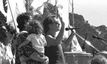"""""""Shine it back to him.""""  Bob Weir speaks to the crowd during the public memorial for his bandmate and friend, the late Jerry Garcia at the Polo Fields in San Francisco's Golden Gate Park, August 13, 1995."""