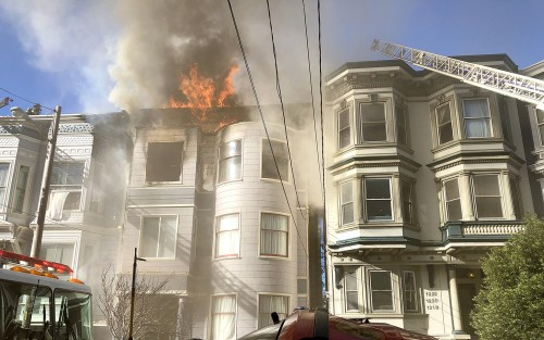 San Francisco firefighters attempt to put out a fire in the 1200 block of Page Street in San Francisco, February 18, 2019.  Cause of the fire was still unknown as of late evening.  Photo by Stephen Dorian Miner