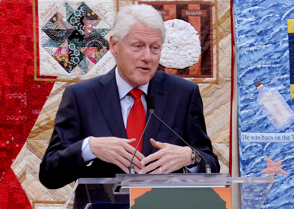 Former President Bill Clinton addresses the audience during the annual World AIDS Day event at the AIDS Memorial Grove in San Francisco's Golden Gate Park, December 1, 2017.